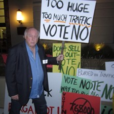 Holding a picket sign outside City Hall on February 4, 2014. The sign says it all. I was so proud to see so many of my fellow citizens standing up for their beliefs that night.