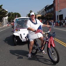 Riding an electric assist Bicycle during the 4th Of July Parade. Commissioner Toy is in the golf cart behind me.