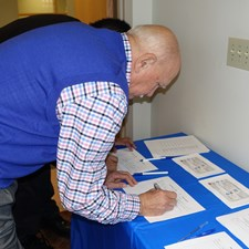 Volunteers signing up for Team Cia! - Photo by AG Price