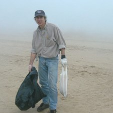 Jeff at a beach cleanup. Saving the environment is everybody's job.